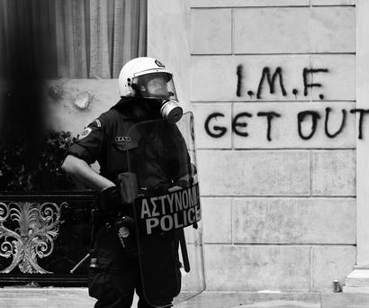 PROTEST: A riot policeman on duty during demonstrations over austerity measures in Athens in 2010