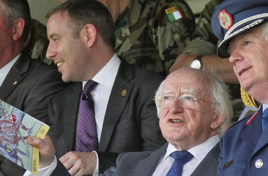 AT THE MATCH: President Higgins, centre, pictured at Tolka Park with his Executive Assistant Kevin McCarthy, on left of picture