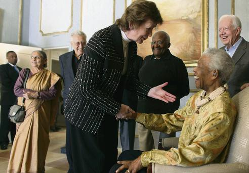 Nelson Mandela shakes hands with Mary Robinson during a meeting of The Elders in Johannesburg in May 2010.