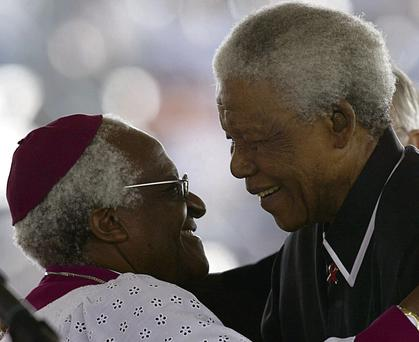 Nelson Mandela hugs South African Anglican Bishop Desmond Tutu as they pay tribute to their late friend Walter Sisulu at the apartheid struggle figure's funeral in Soweto, South Africa, in 2003.