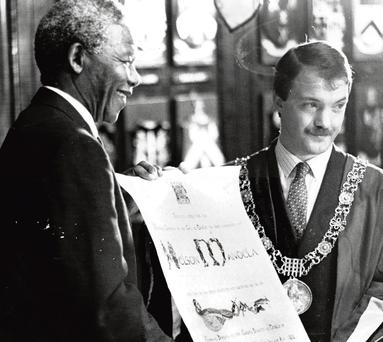 Nelson Mandela is presented with his Freedom of Dublin certificate by Sean Haughey in 1990.