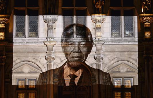 ICON: An image of Mandela projected on Paris town hall, last Friday; the same day the South African flag flew at half mast outside the embassy in Dublin