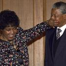 CHANGES: Winnie playfully silences her husband in 1990