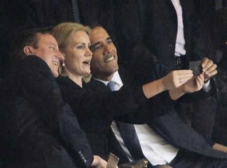Barack Obama and David Cameron pose for a selfie with Danish leader Helle Thorning-Schmidt at Nelson Mandela's memorial service