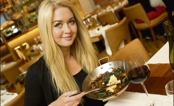 Niamh Horan in Fade Street Social restaurant, Dublin, with a dish of horse meat cooked by chef Dylan McGrath (photo: Gerry Mooney)