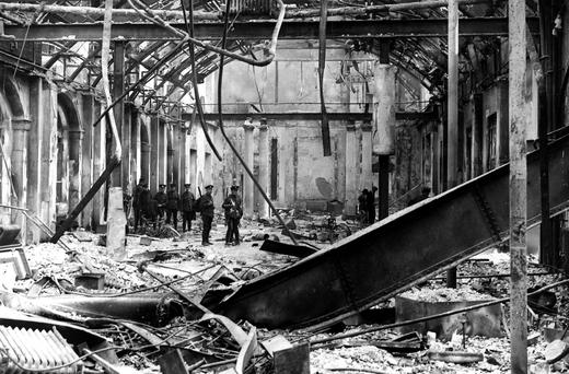 British troops inspect the ruins of the GPO after the 1916 Rising