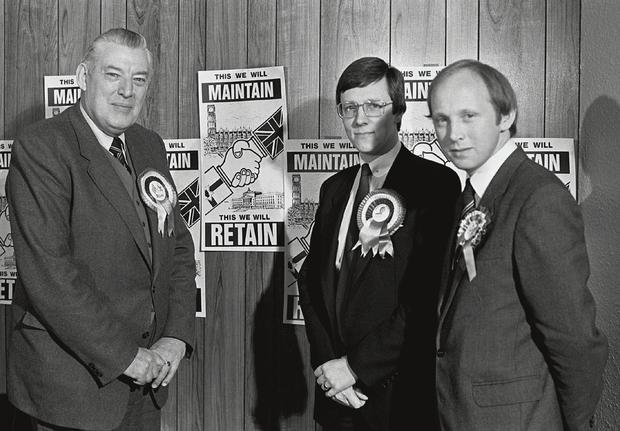 The DUP's Ian Paisley and Peter Robinson during an election campaign in the 1970s.