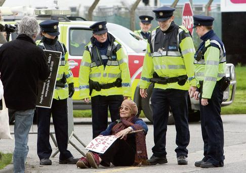 Making the point: Margaretta D'Arcy stages a sit-down protest as the Shannonwatch and other peace/anti-war groups gather at Shannon Airport to mark the ninth anniversary of the invasion of Iraq. Photo: Brian Gavin Press 22.