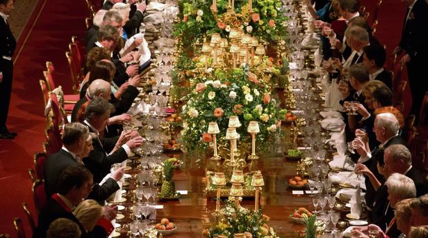 RAISING A GLASS: Guests toast after speeches by Queen Elizabeth and President Michael D Higgins at the royal banquet in Windsor Castle. Reuters