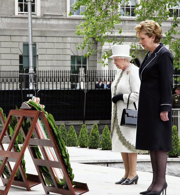 The Queen and President Mary Robinson at the Garden of Remembrance in Dublin on May 17, 2011.