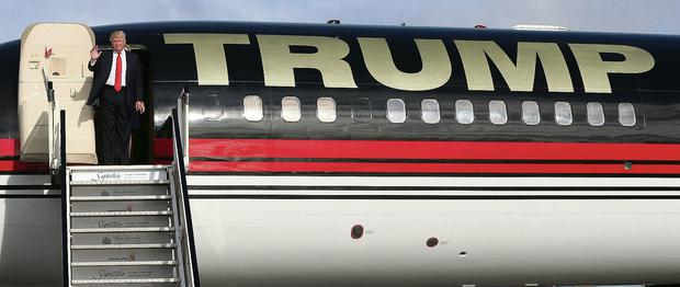 High flyer: US billionaire Donald Trump about to step off his private plane at Shannon Airport after flying into Ireland to inspect the golf course and luxury resort in Co Clare he bought for a bargain €15m last year NIALL CARSON