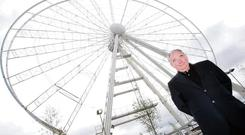 Harry Crosbie stands at the then under-construction big wheel beside the O2. Photo: Conor Healy
