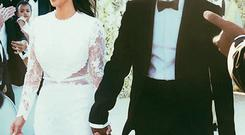 Kim Kardashian and Kanye West at their wedding in Florence, Italy. Photo: E! News