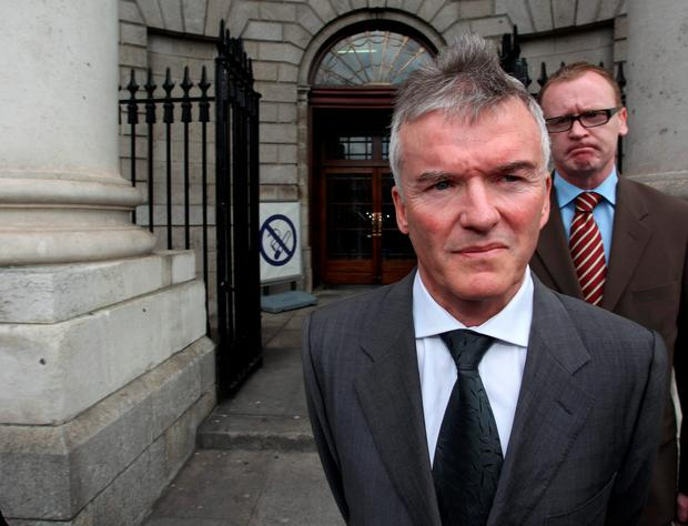 Ivor Callely (front) outside court