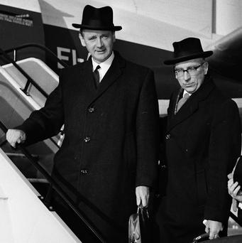 Ex-Taoiseach Jack Lynch and Finance Secretary TK Whitaker board a plane for talks with then British PM Harold Wilson in 1966