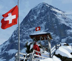 INSURMOUNTABLE BARRIER: A ski instructor poses on the Kleine Scheidegg in front of the north face of the Eiger in Switzerland. Photo: Rupert Sprich/Reuters
