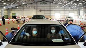 Eva Martinez and Sandra Vaden receive their vaccinations against coronavirus disease at a drive-through site in Robstown, Texas. Photo: REUTERS/Go Nakamura