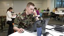 Defence Forces Cadet John Higgins working at the contact-tracing call-centre in the O'Brien Science Centre in UCD back in March. Photo: Frank McGrath