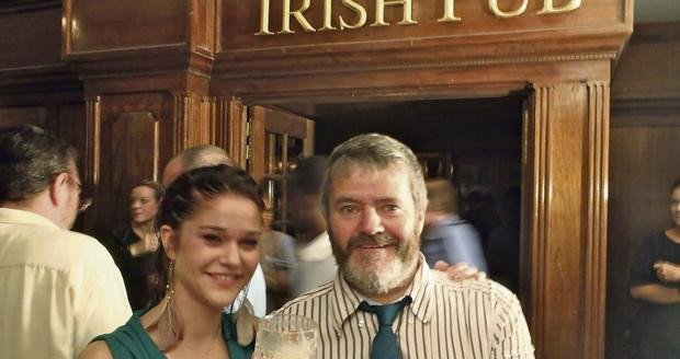 'When they are good, Irish pubs are amazing ambassadors,' Enda O ' Coineen with a patron in an Irish pub in Haiti