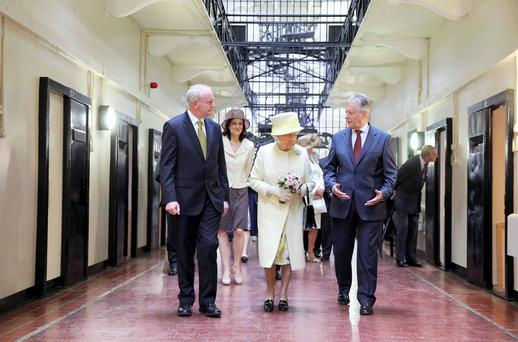SIDE BY SIDE: Queen Elizabeth with deputy First Minister Martin McGuinness, left, and Northern Ireland First Minister Peter Robinson in Belfast. Photo: Reuters/Kelvin Boyes/Pool