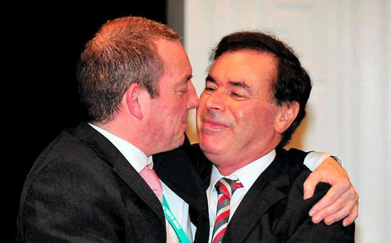 Fine Gael TD Jerry Buttimer hugs former Justice Minister Alan Shatter after a same-sex marriage motion was passed at last year's Fine Gael Ard Fheis
