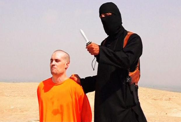 American journalist James Foley with his killer, who has been dubbed 'Jailer John'