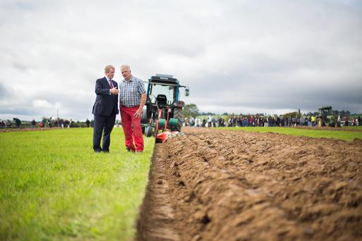 Taoiseach Enda Kenny meets with conventional World champion plougher Eamon Tracey from Carlow on the final day of the 2014 National Ploughing Championships at Ratheniska, Co. Laois. Photo:Mark Condren