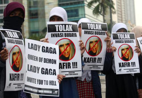 Muslim women in Indonesia protesting against a Lady Gaga concert. There were worries in the country that the star's sexy clothes and dance moves could undermine Islamic values and corrupt the country's youth.