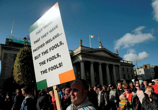 Protesters march on the streets of Dublin during a demonstration against water charges. Photo: PA