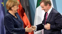 Taoiseach Enda Kenny is simply a messenger boy for the EU establishment and German chancellor Angela Merkel.