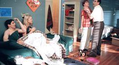 Actors Jason Biggs and Joelle Carter are caught in bed in a college dorm by parents Molly Cheek and Eugene Levy in a scene from the teen comedy film 'American Pie 2