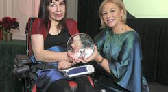 Roberta 'Bobby' Connolly receiving her road safety award from chairperson of the Road Safety Authority Liz O'Donnell in Farmleigh House