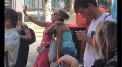 Inappropriate: Two girls are photographed mid-selfie at the scene in Sydney
