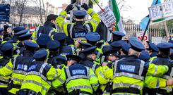 Taking to the streets: Protesters show their anger during a water charges demonstration in Dublin. Photo: Collins Photos