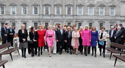 GIRL POWER: Taoiseach Enda Kenny with TDs and Senators from all parties celebrate International Women's Day in Leinster House in 2012