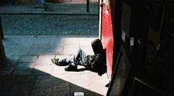A homeless teenager sitting in a doorway in Dublin's Temple Bar. Photograph: Robert Carson.