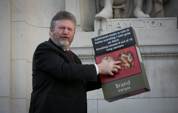 Dr James Reilly has introduced plain-packaging legislation