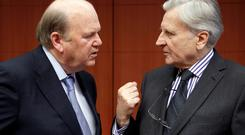 FRANKFURT'S WAY: Finance Minister Michael Noonan and former president of the European Central Bank Jean-Claude Trichet