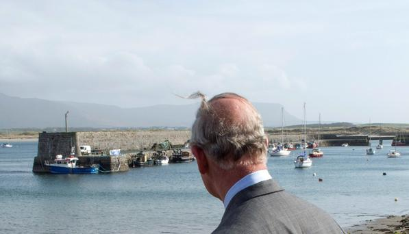 TIME FOR REFLECTION: The image of Prince Charles looking out to sea from Mullaghmore Harbour may be the most significant image of the recent life of these two islands with their fused histories