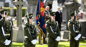 STATE COMMEMORATION: A minute's silence is observed at the grave of Jeremiah O'Donovan Rossa in Glasnevin Cemetery last Saturday week Photo: Gerry Mooney