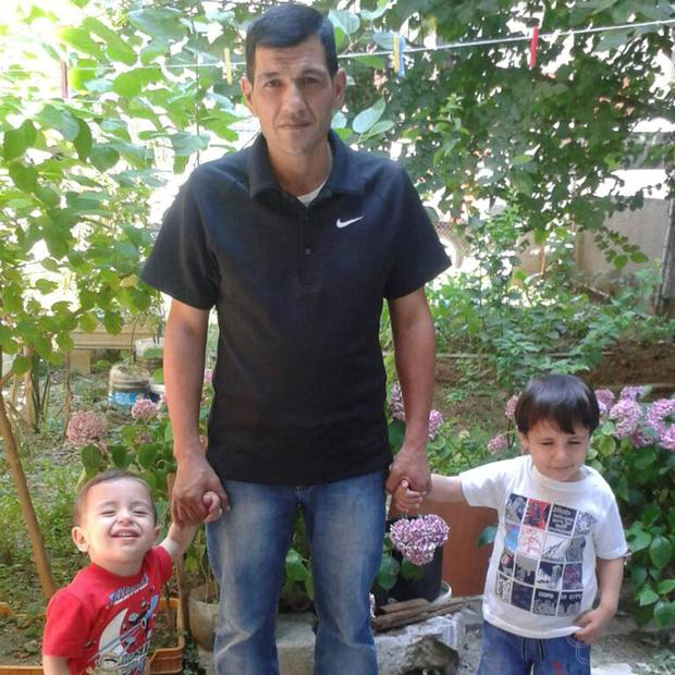 Grieving father: Abdullah Kurdi with his two sons, Aylan and Galib, who drowned with their mother and other refugees as they tried to reach Greece