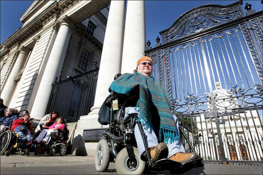 A LIFE OF THEIR CHOOSING: Martin Naughton, of the Centre for Independent Living, protesting outside Government Buildings. Martin has devoted his life to trying to free people with disabilites from institutions