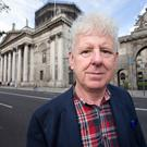 Senior Council Michael O'Higgins who has just written his debut novel 'Snapshots' outside Dublin's Four Courts