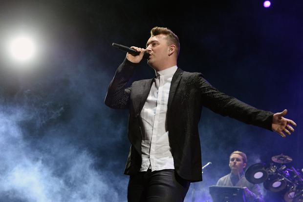 Hitting the high notes: Sam Smith's new Bond theme 'Writings on the Wall' has made it to the top of the charts.