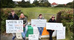 Divided: Protesters (not residents) Stephen, Mark, Kim and Susan, who are in favour of the Travellers moving to the new location, demonstrate at the entrance to the proposed site at Rockville Drive in Carrickmines, Dublin.