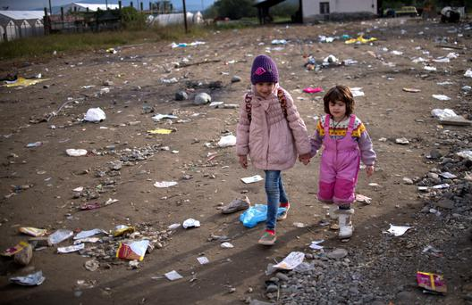 Migrant children arrive at the registration camp after crossing the Greek-Macedonian border near Gevgelija