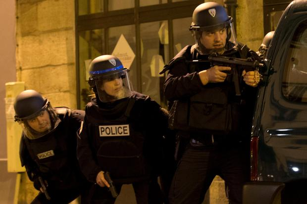 French police secure a perimeter in Paris. Thousands of troops have been deployed around the city following the deadly terrorist attacks