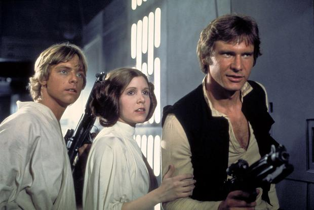 Actors, from left, Mark Hamill as Luke Skywalker, Carrie Fisher as Princess Leia and Harrison Ford as Han Solo, appear in a scene from Lucasfilm's