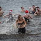 Making a splash: Some of the Christmas Day swimmers who braved the elements.