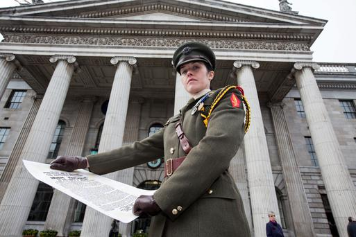 Captain Kate Hanrahan with the Proclamation outside the GPO during the commemoration to mark the 99th anniversary of the 1916 Rising. Photo: Mark Condren